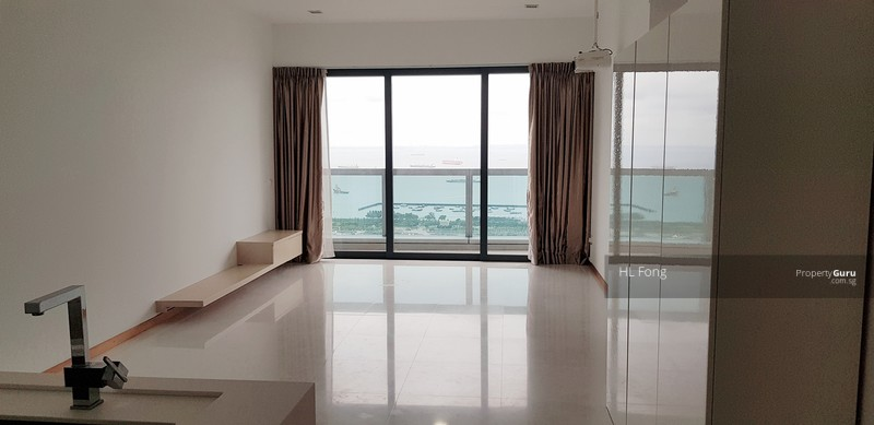 Living room with balcony overlooking the sea