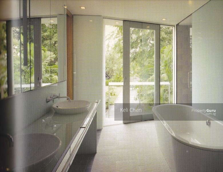 Walk in bathroom with modern bathtub and his and hers basin