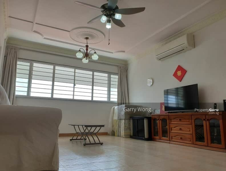 Living room fitted with ceiling fan and aircon.